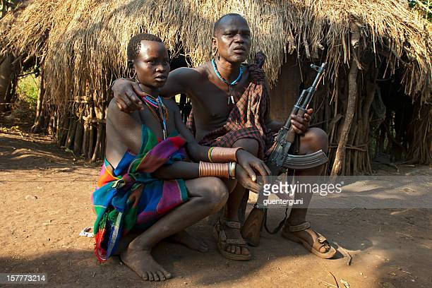 chief of the village and his wife, surma, southern ethiopia - ak 47 stock photos and pictures