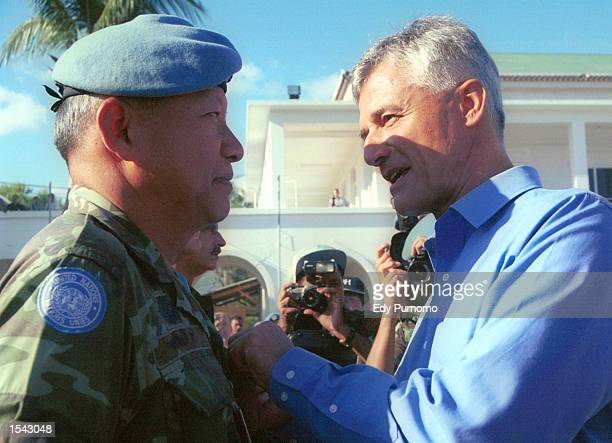 Chief of United Nations Transitional Administration in East Timor Sergio De Mello awards a medal to a UN peacekeeping soldier during a farewell...