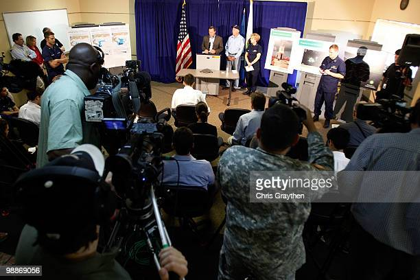 Chief Operating Officer Doug Suttles speaks as Interior Secretary Ken Salazar and US Coast Guard Rear Admiral Mary Landry listen during a press...