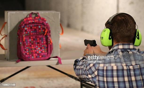 Chief Operating Officer for Amendment II Rich Brand shoots a child's backpack with their Rynohide CNT Shield in it on December 21 2012 in Salt Lake...