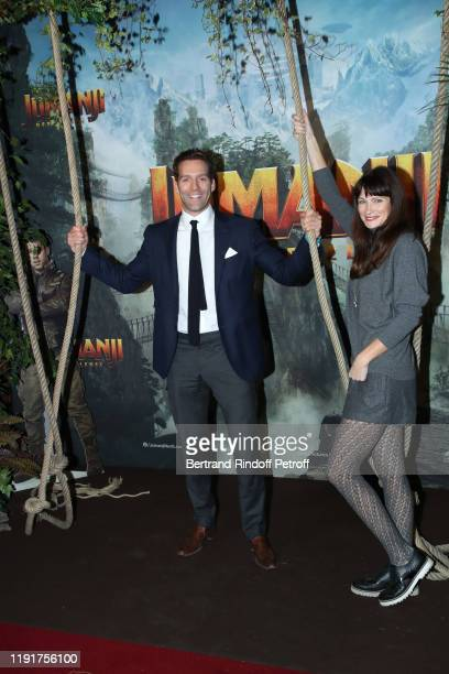 Chief Operating Officer of 'Le Grand Rex' Alexandre Hellmann and his wife attend the photocall of the Jumanji Next Level film at le Grand Rex on...