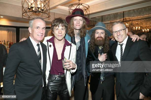 Chief Operating Officer of RCA Records Tom Corson musicians Matt Shultz Daniel Tichenor and Matthan Minster of Cage the Elephant and CEO of RCA...