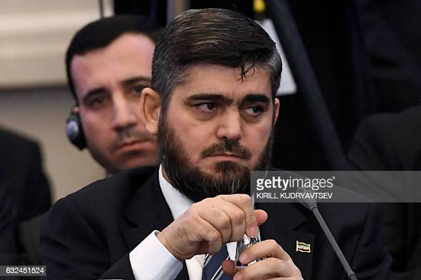 Chief opposition negotiator Mohammad Alloush of the Jaish alIslam rebel group attends the first session of Syria peace talks at Astana's Rixos...