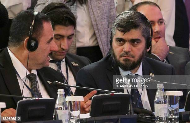 Chief opposition negotiator Mohammad Alloush of the Jaish alIslam rebel group speaks with his colleague during the second session of Syria peace...