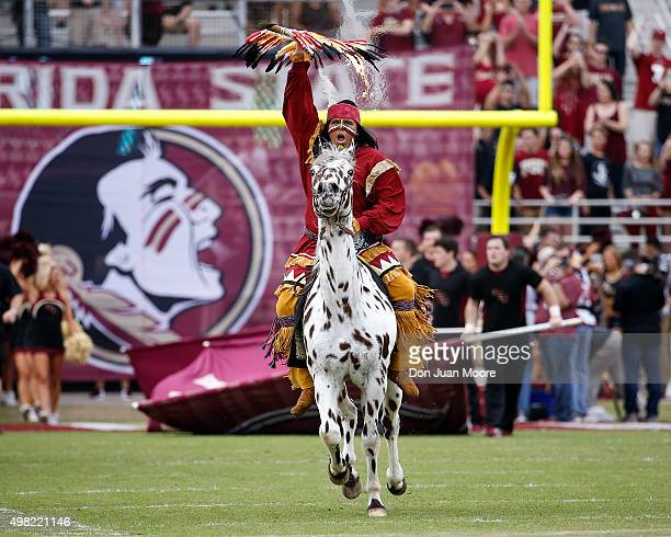 Chief Osceola and Renegade of the Florida State Seminoles take to the field before the game against the Chattanooga Mocs at Doak Campbell Stadium on...