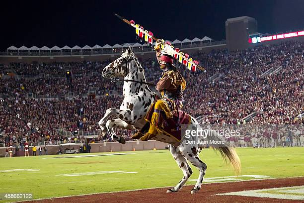 Chief Osceola and Rengade of the Florida State Seminoles takes to the field during the game against the Virginia Cavaliers at Doak Campbell Stadium...