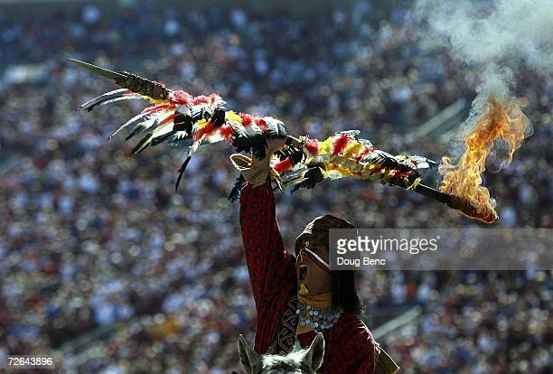Chief Osceola of the Florida State Seminoles holds up a flaming spear during the pre-game ceremony before taking on the Florida Gators at Doak...