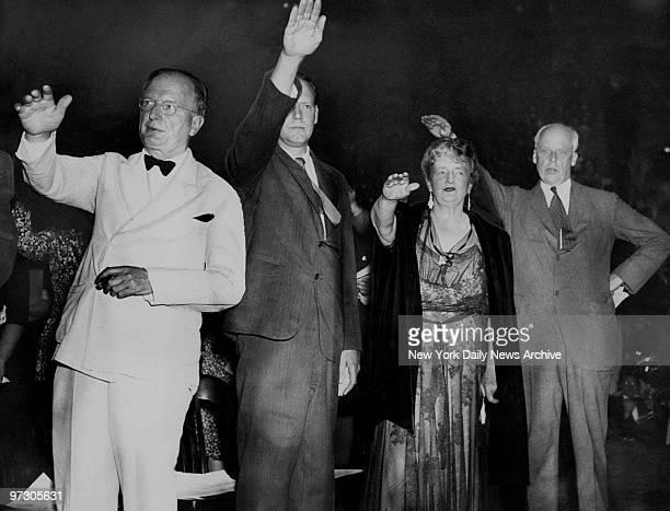 Chief participants in antiwar rally in Madison Square Garden pledge allegiance to American flag Senator Wheeler Charles A Lindbergh novelist Kathleen...