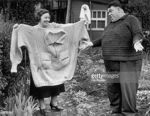 Chief Petty Officer George Cook the heaviest man in the Navy one of the heroes of Narvik with a jersey he received from the Newfoundland War...