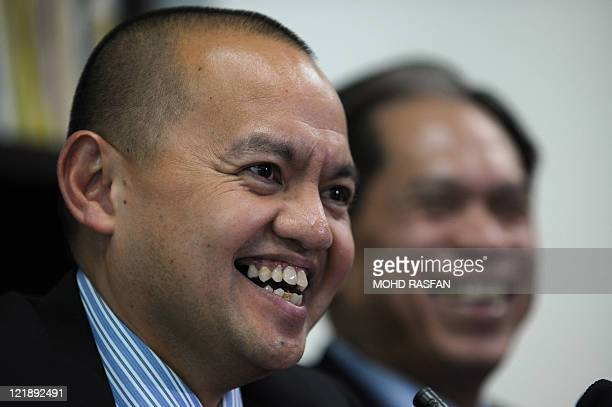 Chief Philippine government negotiator Marvic Leonen smiles during an interview at the Philippine embassy in Kuala Lumpur on August 23 2011 Muslim...