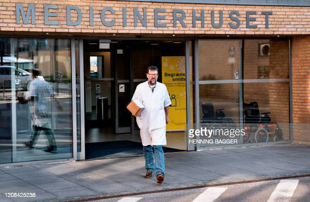 Chief Physician Henrik Nielsen at Aalborg University Hospital arrives to talk to the press as he holds a cooling box containing Remdesivir drug,...