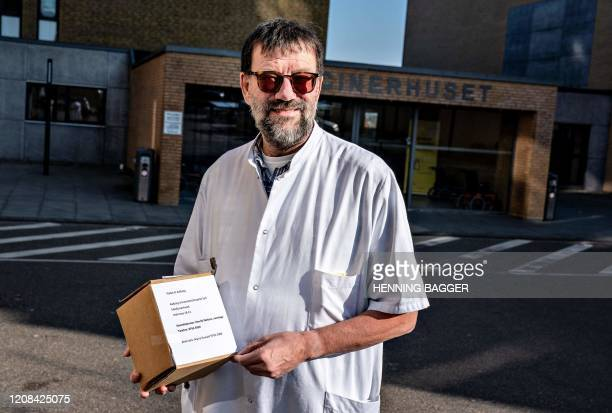 Chief Physician Henrik Nielsen at Aalborg University Hospital holds a cooling box containing Remdesivir drug, which a Covid-19 positive patient will...