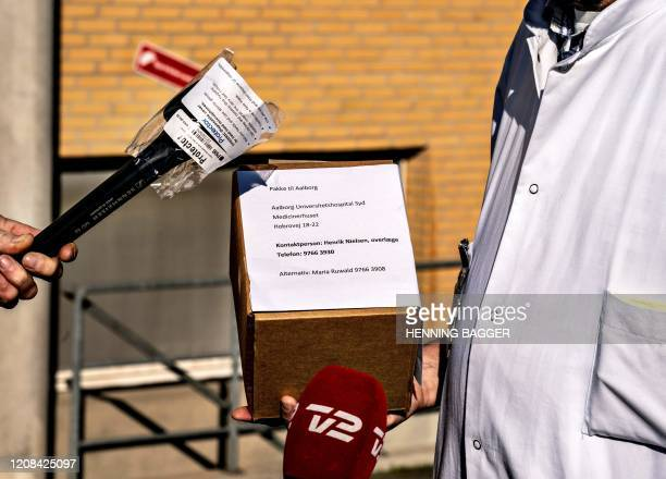 Chief Physician Henrik Nielsen at Aalborg University Hospital talks to the press as he holds a cooling box containing Remdesivir drug, which a...