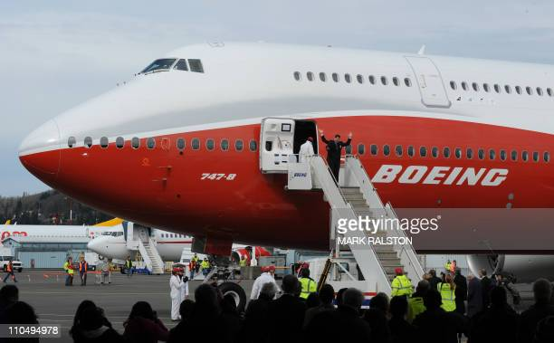 Chief Pilot Mark Feuerstein leaves the 747-8 Intercontinental, Boeing's largest-ever passenger airplane, after landing from it's inaugural flight, at...