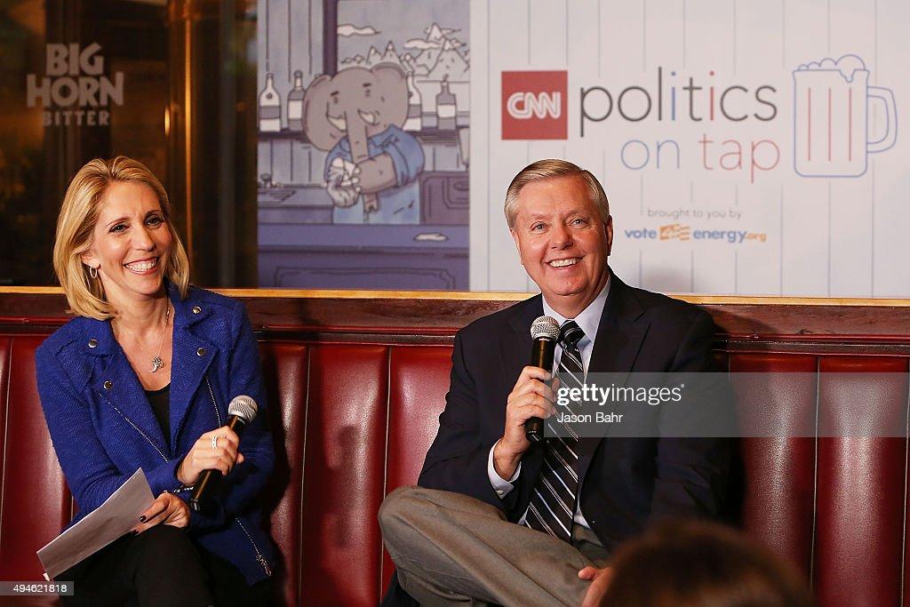 Chief political correspondent Dana Bash (L) interviews Senator Lindsey Graham during CNN's Politics On Tap at Walnut Brewery on October 27, 2015 in Boulder, Colorado. 25763_001