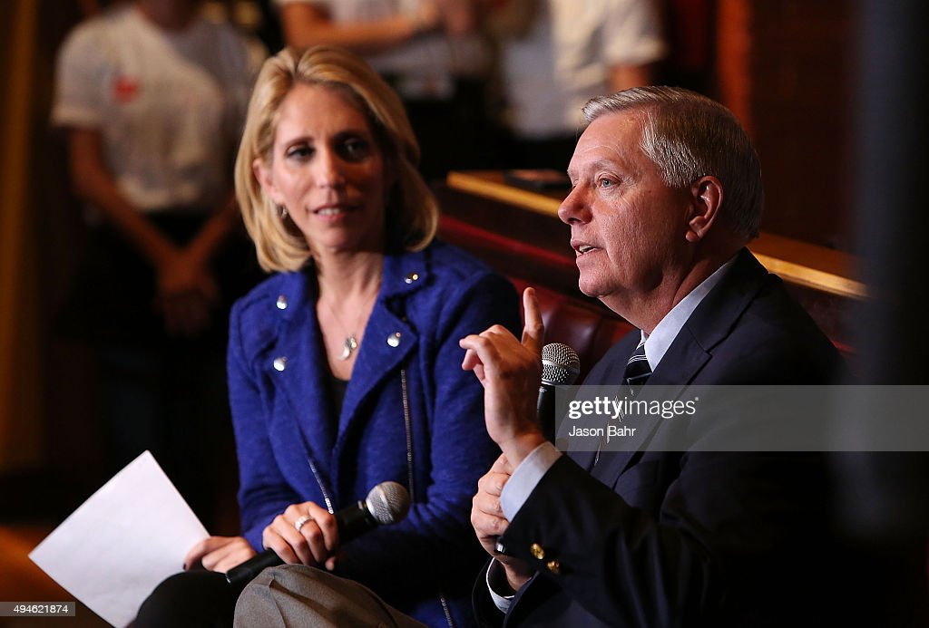 Chief political correspondent Dana Bash (L) laughs with Senator Lindsey Graham during CNN's Politics On Tap at Walnut Brewery on October 27, 2015 in Boulder, Colorado. 25763_001