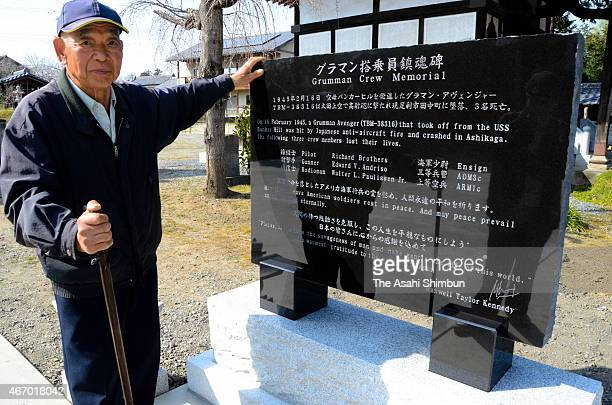 Chief priest Nobuo Kizaki stands next to a cenotaph dedicated to three U.S. Airmen at Seiganji temple on March 16, 2015 in Ora, Gunma, Japan. To...