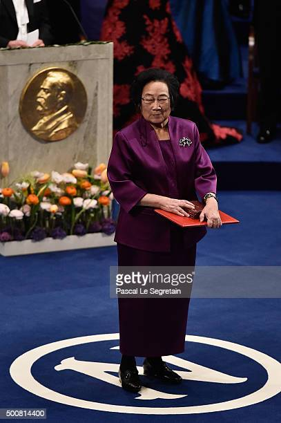Chief Professor Tu Youyou laureate of the Nobel Prize in Physiology or Medicine acknowledges applause after he received his Nobel Prize from King...