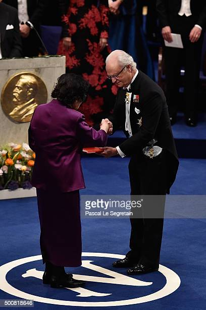 Chief Professor Tu Youyou laureate of the Nobel Prize in Physiology or Medicine receives her Nobel Prize from King Carl XVI Gustaf of Sweden during...