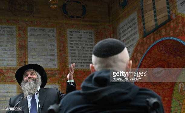 Chief Rabbi of Ukraine Moshe Reuven Azman gives a speech during the opening ceremony of a symbolic synagogue at Babi Yar , a place in Kiev where the...