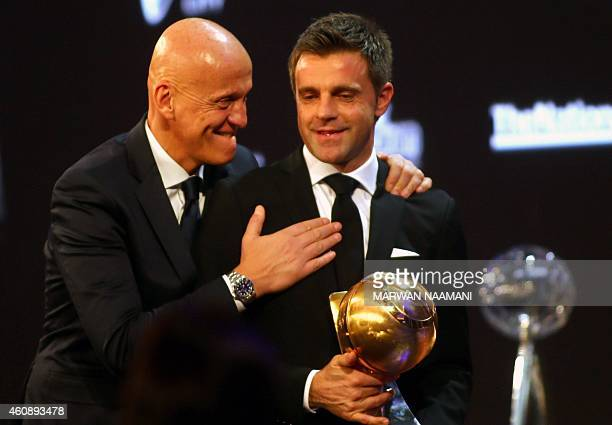 UEFA chief refereeing officer Pierluigi Collina congratulates Italian referee Nicola Rizzoli after he won the 'Best referee of the Year' award during...