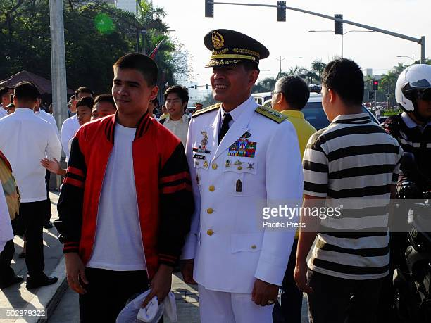 PNP chief Ricardo Marquez readily posed for a photo with a male spectator