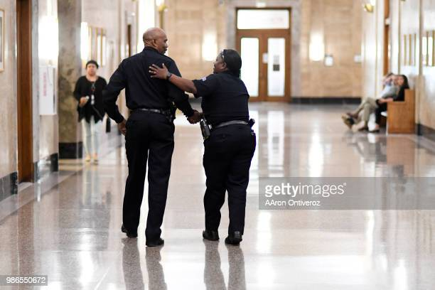 Chief Robert White shakes hands with Sgt Carla Havard before Commander Paul Pazen is introduced as Denver's new chief of police on Thursday June 28...