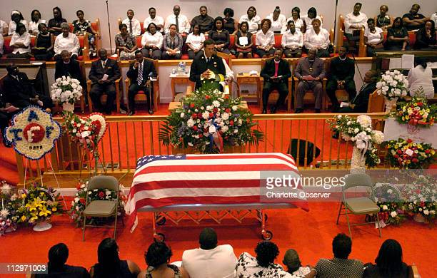 """Chief Rusty Thomas of the Charleston Fire Department shares stories of the late James """"Earl"""" Allen Drayton during his funeral service at Joshua..."""