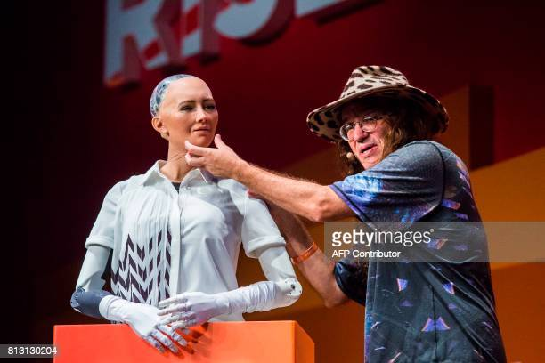Chief scientist of Hanson Robotics Ben Goertzel describes to the audience what 'Sophia the Robot' is made of during a discussion about the future of...