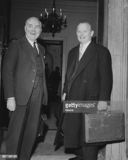 Chief Secretary to the Treasury Henry Brooke and Chancellor of the Exchequer Selwyn Lloyd arriving for a cabinet meeting at Admiralty House London...