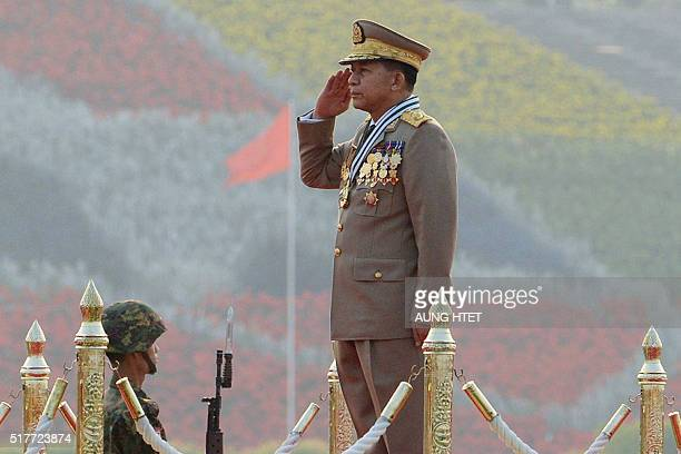 Chief Senior General Min Aung Hlaing commander in chief of the Myanmar armed forces salutes during a ceremony to mark the 71st Armed Forces Day in...
