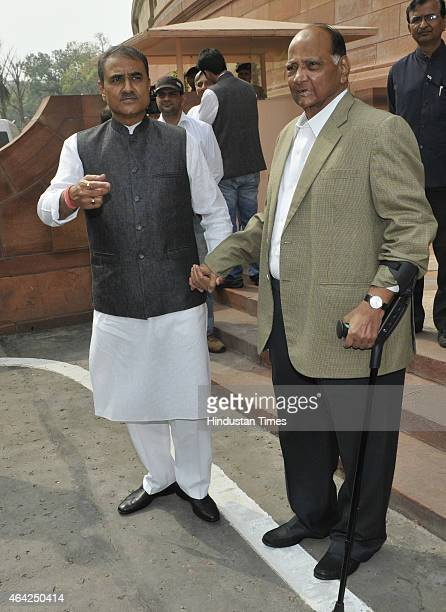 Chief Sharad Pawar with NCP leader Praful Patel come out after the Presidential address of both houses on the first day of Budget Session at...