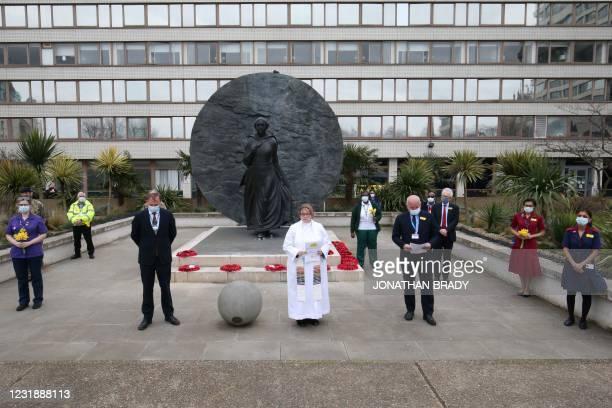 Chief Spiritual Adviser Mia Hilborn stands with NHS England Chief Executive Sir Simon Stevens and Guys and St Thomas' NHS Trust Chief Executive and...