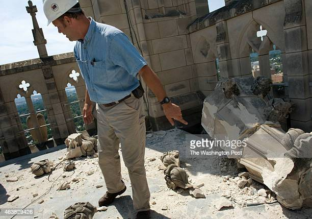 Chief stonemason Joe Alonso examines the damage to the Gloria in Excelsis tower of the Washington National Cathedral a day after a 58 magnitude...