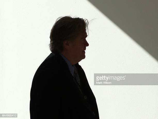 Chief Strategist Steve Bannon follows US President Donald Trump walks into the Oval Office after arriving back at the White House on February 24 2017...