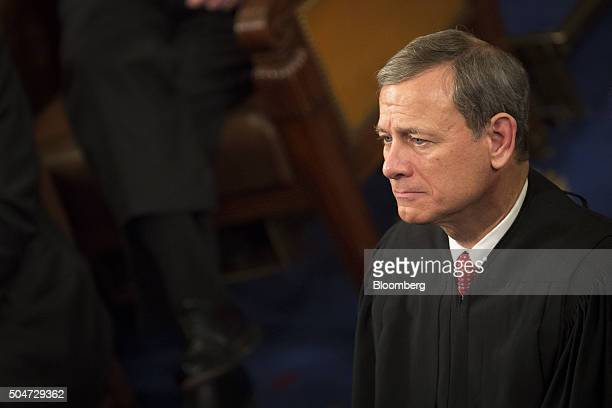 Chief Supreme Court Justice John Roberts listens as U.S. President Barack Obama delivers the State of the Union address to a joint session of...