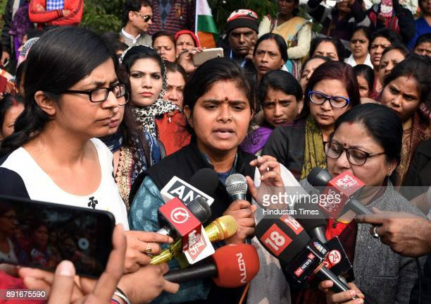 Chief Swati Maliwal with Narela victim Parveen who was discharged from hospital is seen interacting with media at Rajghat area on December 13 2017 in...