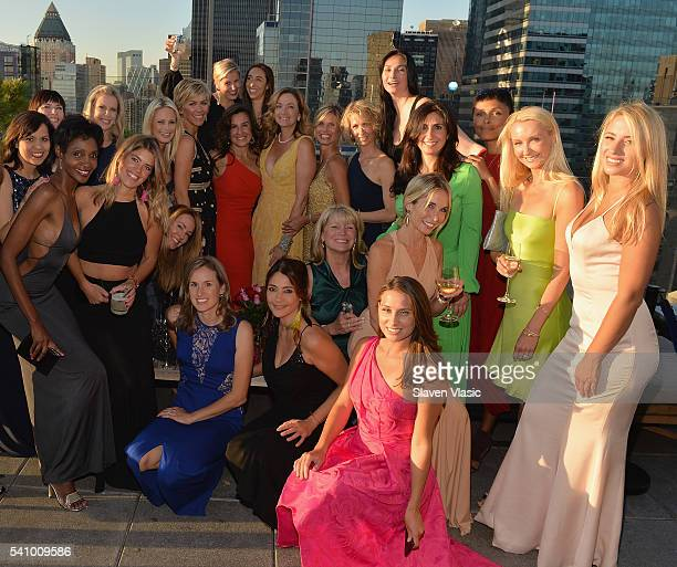 Chief Technology Officer at Estee Lauder Rhonda Vetere poses with her guests during Rhonda Vetere's Beauties and Gowns gathering at The Skylark on...