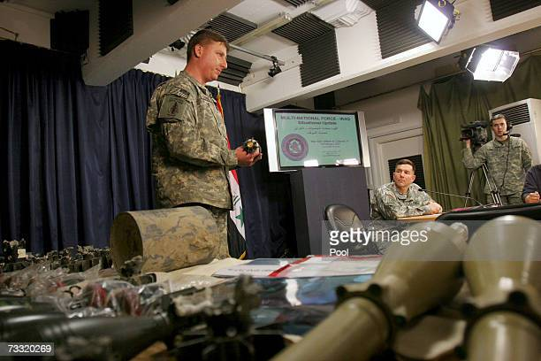 Chief U.S. Military spokesman, Maj. Gen. William Caldwell watches as a U.S. Army officer holds a mortar round, purported to be a piece of evidence...