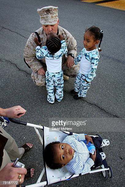 Chief Warrant Officer Gary Walker gets a kiss from his threeyearold daughter Angel while Eliana also three years old waits her turn and Isaiah one...