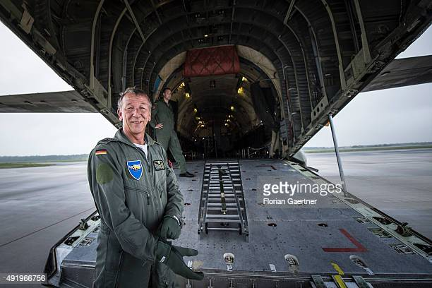 Chief Warrant Officer Michael Stark stands in front of a loading ramp of German Air Force Plane Transall on October 06 2015 in Weeze Germany