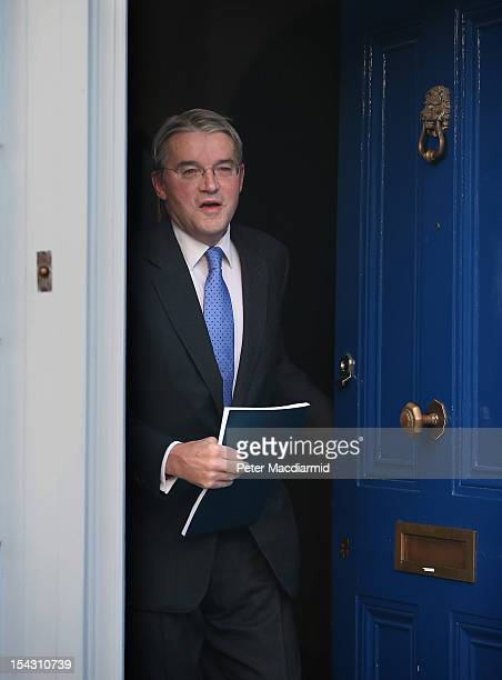 Chief Whip Andrew Mitchell leaves his house on October 18 2012 in London England Mr Mitchell is facing continuing criticism and pressure to resign...