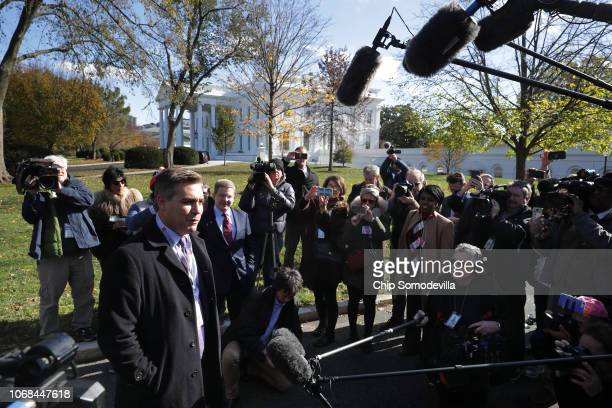 CNN chief White House correspondent Jim Acosta talks to fellow journalists as he returns to the White House after Federal judge Timothy J Kelly...