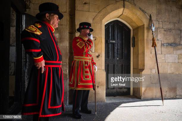 Chief Yeoman Warder Pete McGowran radios a colleague ahead of a ceremonial event to mark the reopening to the public of the Tower of London on July...