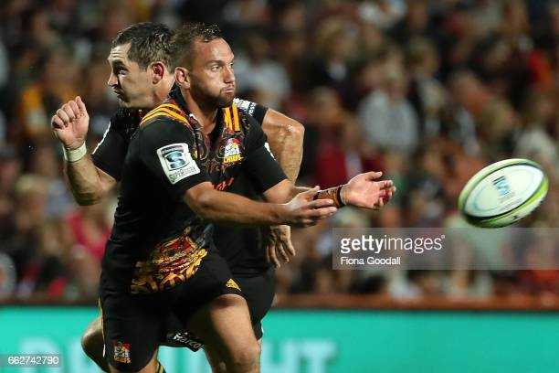 Chiefs' Aaron Cruden passes with support from Stephen Donald during the round six Super Rugby match between the Chiefs and the Bulls at Waikato...