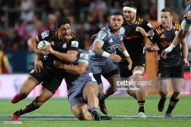 Chiefs Anton Lienert-Brown is tackled during the round seven Super Rugby match between the Chiefs and the Hurricanes at Waikato Stadium on March 13,...