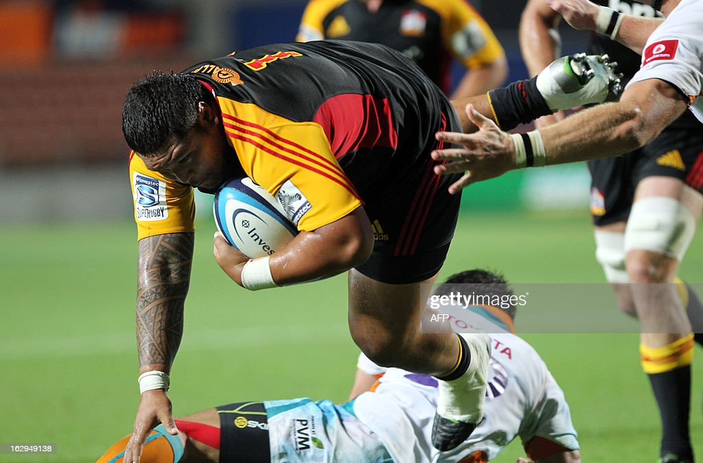 Chiefs Ben Tameifuna dives in to score a try during the Super Rugby match between the Chiefs and the Cheetahs played at Waikato Stadium in Hamilton on March 2, 2013. New Zealand's Waikato Chiefs defeated South Africa's Central Cheetahs 45-3. AFP PHOTO / Michael BRADLEY