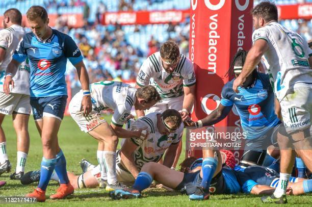 Chiefs' Brodie Retallick scores a try next to the upright during Super Rugby union match between Bulls and Chiefs at the Loftus Versveld Stadium in...