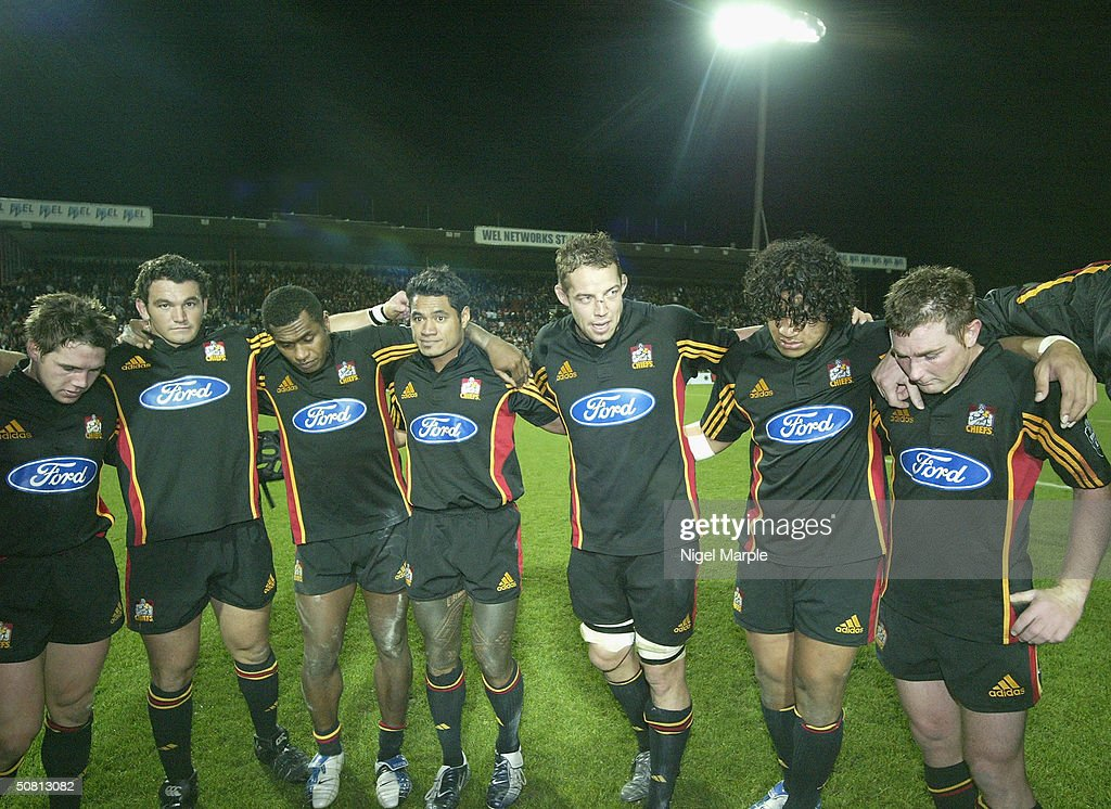 Chiefs captain Jonno Gibbs #4 (C) celebrates making the quarter finals with his team despite losing the Super 12 game between the Chiefs and Brumbies at Waikato Stadium in Hamilton, New Zealand on May 8, 2004. The Chiefs scored a point by finishing within 8 points of the Brumbies to go through. The Brumbies won the match 15-12.