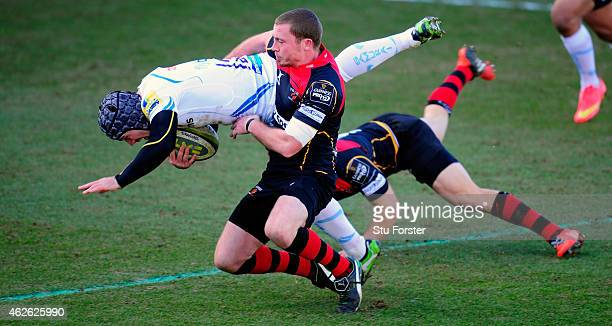 Chiefs centre Adam Hughes is tackled by Richie Rees during the LV= Cup group match between Newport Gwent Dragons and Exeter Chiefs on February 1 2015...